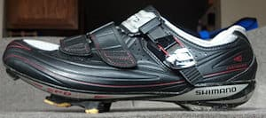 Road cleats protrude from the sole of the shoe making walking uncomfortable