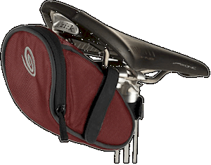 A seat-pack fits up under your saddle and carries all you need to keep you self-sufficient on the road or trail